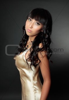 Beautiful woman in gold dress