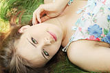 girl lies on grass