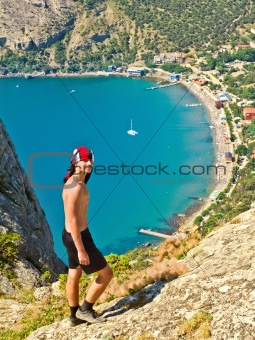 teenager in the mountains above the sea