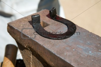horseshoe on  anvil