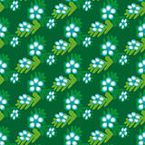 Seamless green background with flowers