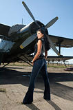  woman in jeans and aircraft