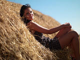 woman on a haystack