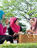 muslim girl picnic with friend at park