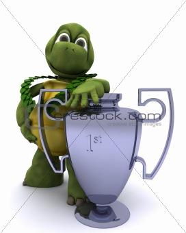 Tortoise with a winners trophy