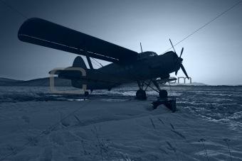 The dark blue plane on snow