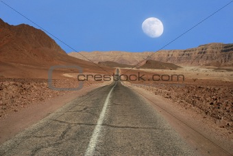 Narrow road through the desert in Israel.