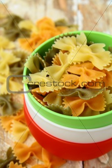 uncooked tricolor pasta in cups in the style of the Italian flag