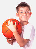Boy and basketball ball