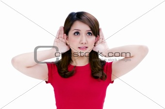 Attractive young woman with hands behind her ears