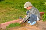 Young Boy Gardening