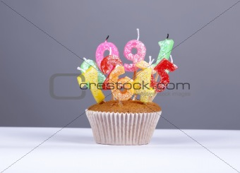 Cake with candles at studio isolated.