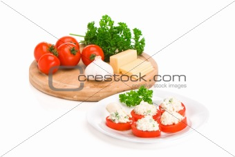 Sliced tomato with cheese and garlic sauce