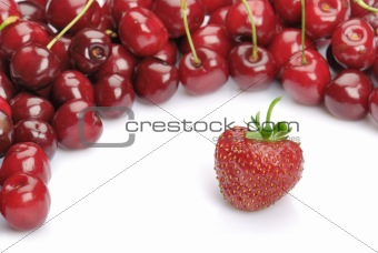 one strawberry and heap of cherries