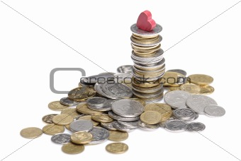 heap and stack of uah coins isolated on white background
