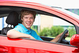 Teenage Boy Sitting In Car, Smiling At The Camera