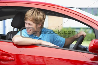 Teenage Boy Sitting In Car
