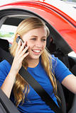Teenage Girl Sitting In Car Talking On Cellphone