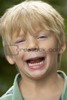Portrait Of Young Boy Laughing