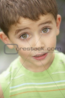 Portrait Of Young Boy Looking Surprised