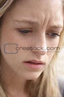 Portrait Of Teenage Girl Looking Upset