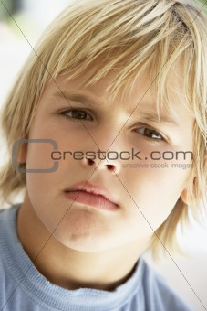Portrait Of Young Boy Frowning