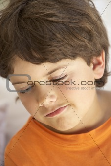 Portrait Of Young Boy Sulking