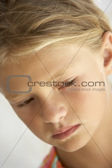 Portrait Of Girl Looking Unhappy