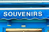 souvenirs sign on wet blue surface