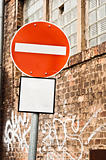 Prohobition traffic sign against abandoned industrial background
