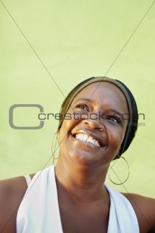 portrait of happy senior caucasian woman looking up and smiling. Vertical shape, copy space