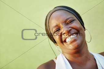black woman with white shirt smiling at camera