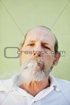 aged caucasian man smoking cigarette