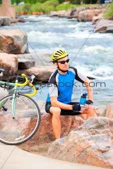 Cyclist sitting by the river