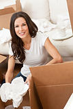 Single Woman Unpacking Boxes Moving House