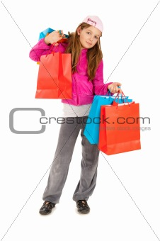 Portrait of beautiful yoYoung girl in pink and gray tracksuit wuth shopping bags isolated on white background ung girl isolated on white background