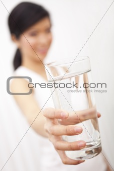 Asian Chinese Girl Holding Glass of Pure Water to Camera