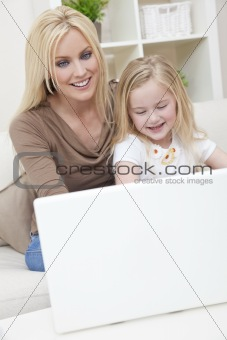 Woman & Girl, Mother and Daughter, Using laptop Computer