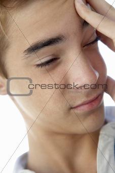 Portrait Of Teenage Boy Rubbing Temples