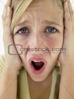 Portrait Of Teenage Girl Screaming