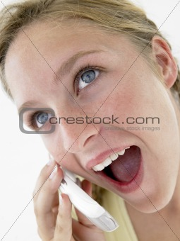 Portrait Of Teenage Girl Smiling And Talking On Cellphone