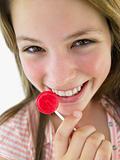 Portrait Of Teenage Girl Eating Lollipop