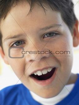 Portrait Of Boy Looking Surprised