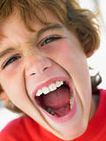 Portrait Of Boy Shouting