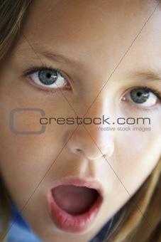 Portrait Of Girl Looking Surprised