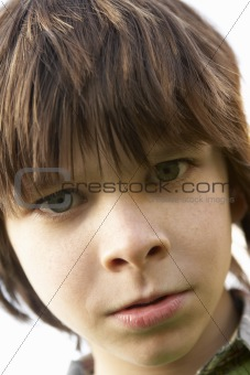 Portrait Of Boy Frowning