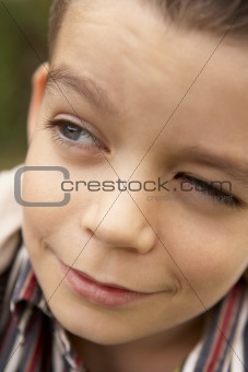 Portrait Of Boy Looking Hopeful