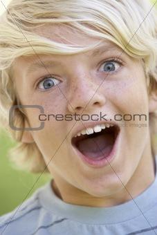 Portrait Of Teenage Boy Looking Excited