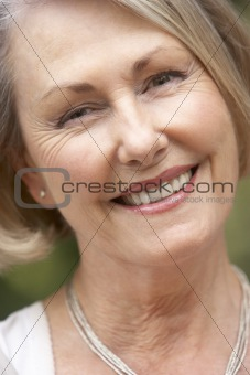 Portrait Of Senior Woman Smiling At Camera