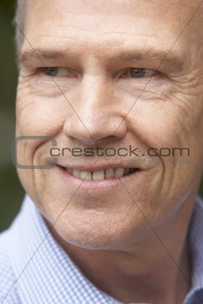 Portrait Of Middle Aged Man Smiling Happily